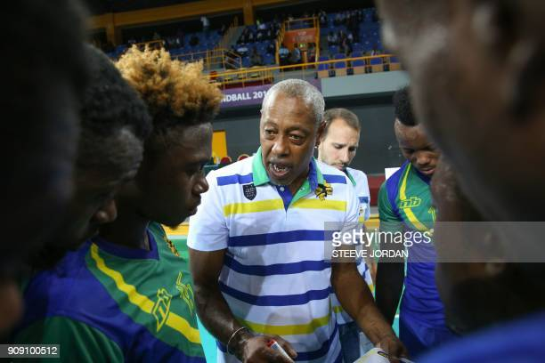Head coach of Gabon's national handball team former international France's Jackson Richardson speaks to his players on January 22 2018 during a pool...