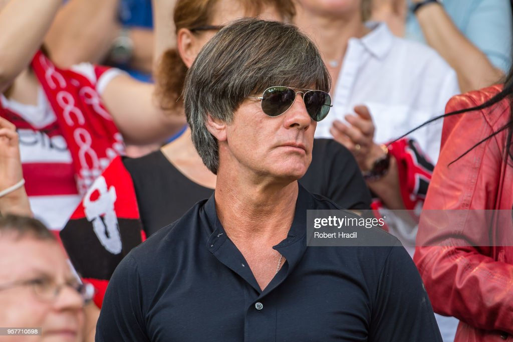 Head coach of Germany Joachim Loew looks on during the Bundesliga match between Sport-Club Freiburg and FC Augsburg at Schwarzwald-Stadion on May 12, 2018 in Freiburg im Breisgau, Germany.