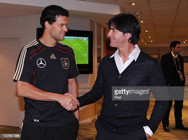 Head coach of Germany Joachim Loew shakes hands with Michael Ballack in the Hotel Southern Sun on July 1 2010 in Capetown South Africa