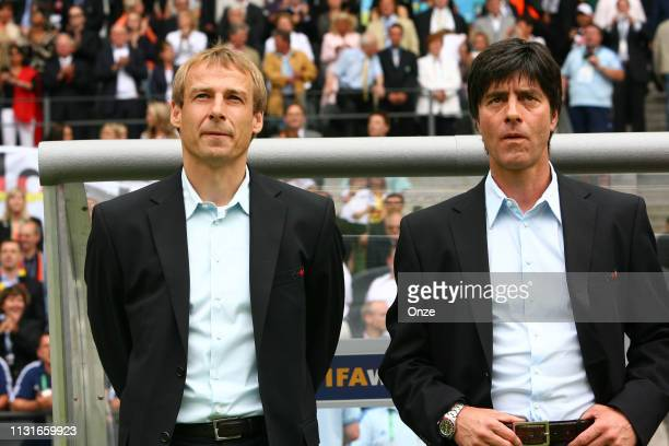 Head coach of Germany Jurgen Klinsmann and his assistant coach Joachim Low during the World Cup quarter finals match between Germany and Argentina at...