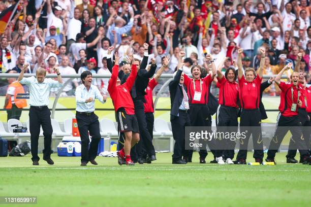 Head coach of Germany Jurgen Klinsmann and his assistant Joachim Low celebrates with the staff during the World Cup quarter finals match between...