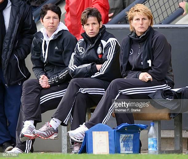 Head coach of Germany Maren Meinert assistance coach Bettina Wiegmann and goalkeeper coach Silke Rottenberg look on during the women's international...