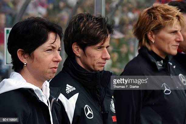 Head coach of Germany Maren Meinert assistence coach Bettina Wiegmann and goalkeeper coach Silke Rottenberg look on during the women's international...
