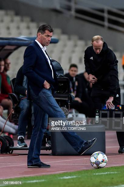 Head coach of Greece Michael Skibbe kicks the ball during the UEFA Nations League football match between Greece and Hungary at the OAKA stadium in...