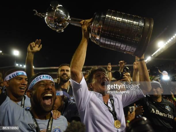 Head coach of Gremio Renato Gaucho raises the trophy after his team wins 2 to 1 in Copa Libertadores final match against Lanus at the Ciudad de Lanus...
