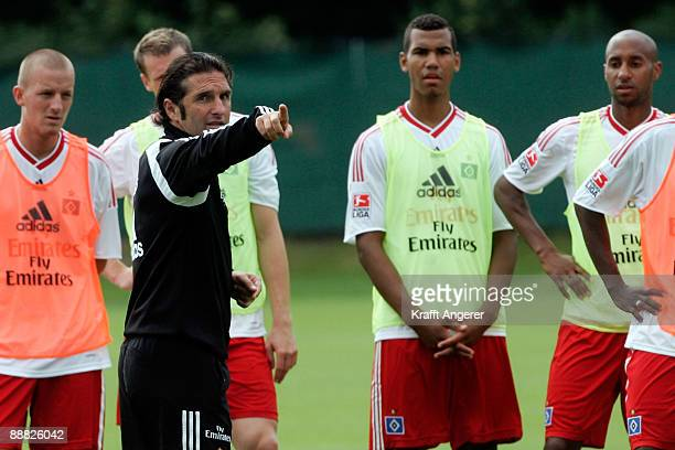 Head coach of Hamburg Bruno Labbadia talks to his players during the Hamburger SV training session at the HSH Nordbank Arena on July 5, 2009 in...