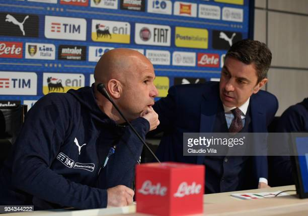 Head coach of Italy Luigi Di Biagio and FIGC Vice Commissioner Alessandro Costacurta chat during a press conference at Centro Tecnico Federale di...