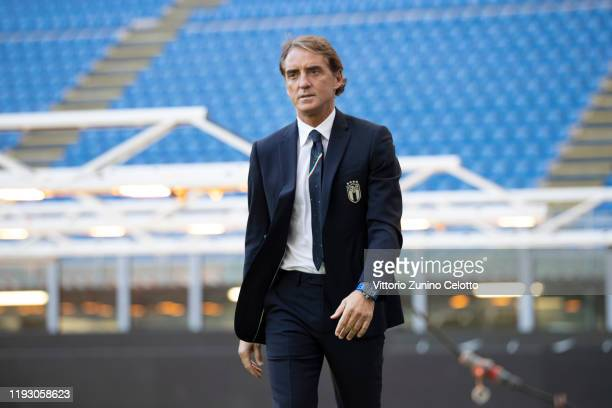 Head coach of Italy Roberto Mancini poses on December 2, 2019 in Milan, Italy. )