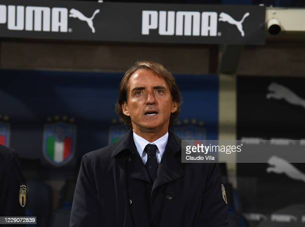 Head coach of Italy, Roberto Mancini sings the national anthem during the UEFA Nations League group stage match between Italy and Netherlands at...