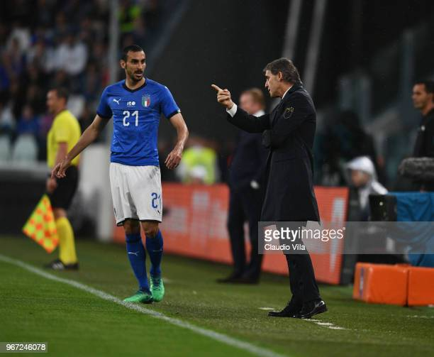 Head coach of Italy Roberto Mancini speaks with Davide Zappacosta during the International Friendly match between Italy and Netherlands at Allianz...