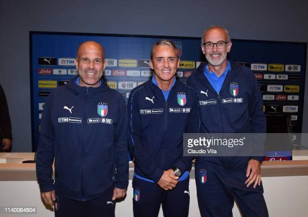 Head coach of Italy U21 Luigi Di Biagio head coach of Italy Roberto Mancini and head coach of Italy U20 Paolo Nicolato pose for a photo during an...