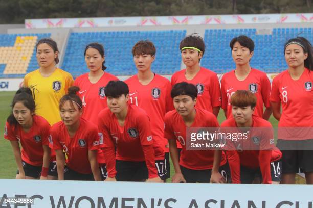 Head coach of Japan Asako Takemoto discusses final remarks with a colleague prior to the AFC during the AFC Women's Asian Cup Group B match between...