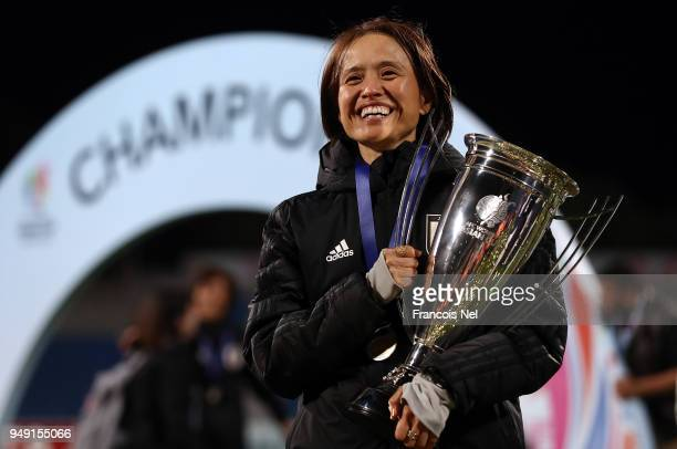 Head coach of Japan Asako Takemoto poses with the trophy after winning the AFC Women's Asian Cup final between Japan and Australia at the Amman...