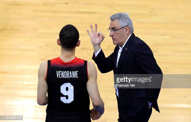 Head Coach of Japan Julio Lamas speaks to Leo Vendrame of Japan during the FIBA Basketball World Cup 2019 Asian Qualifier between Qatar and Japan at...