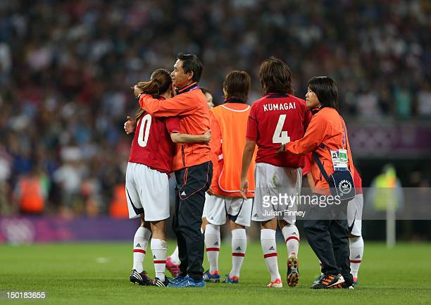 Head coach of Japan Norio Sasaki consoles Homare Sawa after the Women's Football gold medal match between United States and Japan on Day 13 of the...