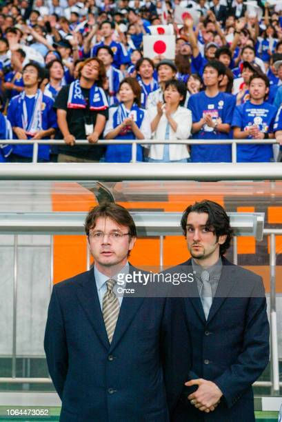 Head coach of Japan Phiippe Troussier and Florent Dabadie during the World Cup match between Japan and Belgium in Saitama Stadium in Saitama Japan on...