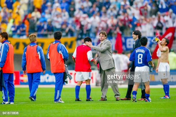 Head coach of Japan Philippe Troussier with his players during the world cup match between Japan and Turkey at Miyagi Stadium in Rifu Japan on june...