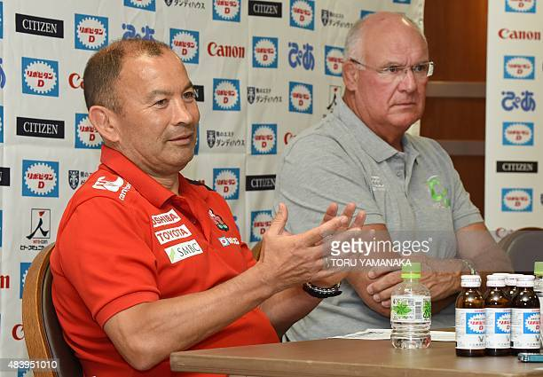 Head coach of Japanese national team Eddie Jones gestures as he answers questions beside assistant coach of World XV Andy Haden during their press...