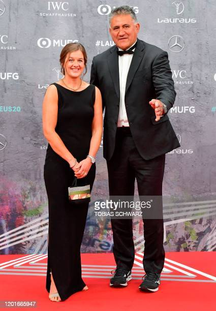 Head Coach of Japan's Rugby Union team Jamie Joseph and a guest pose on the red carpet prior to the 2020 Laureus World Sports Awards ceremony in...