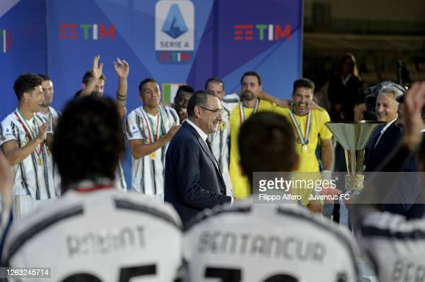 """Head coach of Juventus, Maurizio Sarri, celebrates winning the Italian championship """"scudetto"""" 2019-2020 with the trophy after the Serie A match..."""