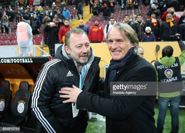 Head coach of Kayserispor Sergen Yalcin and Head coach of Galatasaray Jan Olde Riekerink gesture ahead of the Turkish Spor Toto Super Lig football...
