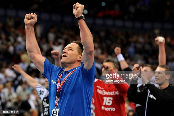 Head coach of Kiel Alfred Gislason celebrates after the Bundesliga match between HSV Hamburg and THW Kiel at the Color Line Arena on May 22 2010 in...
