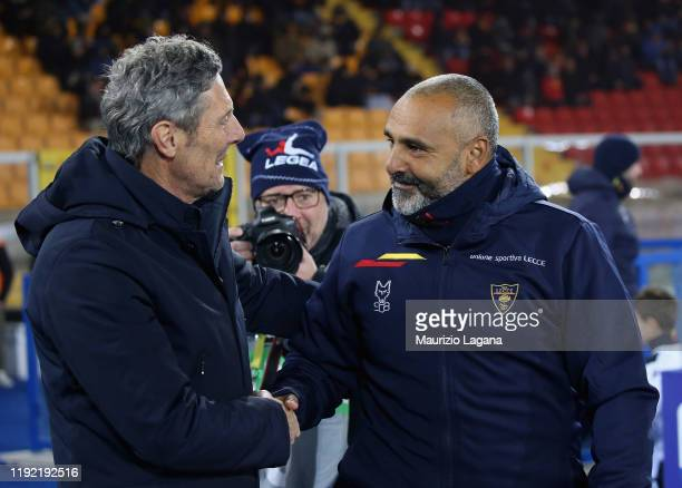 Head coach of Lecce Fabio Liverani salutes head coach of Udinese Luca Gotti during the Serie A match between US Lecce and Udinese Calcio at Stadio...