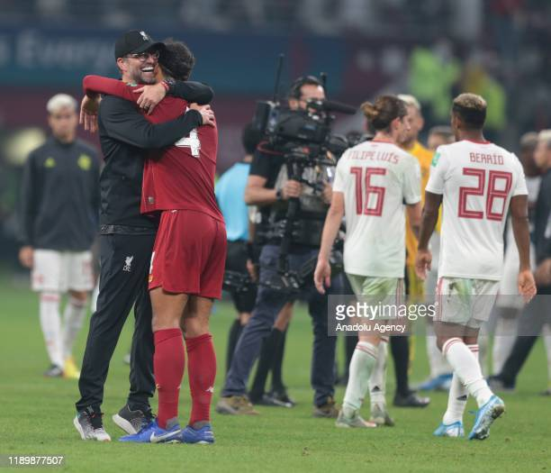 Head Coach of Liverpool Jurgen Klopp and player Virgil van Dijk celebrate their victory at the end of the FIFA Club World Cup Qatar 2019 Final match...