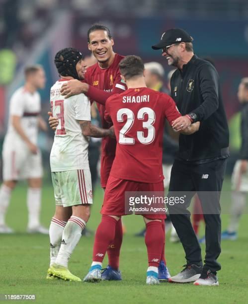 Head Coach of Liverpool Jurgen Klopp players Virgil van Dijk and Xherdan Shaqiri celebrate their victory at the end of the FIFA Club World Cup Qatar...