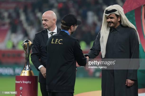 Head Coach of Liverpool Jurgen Klopp shakes hands with President of FIFA Gianni Infantino and Sheikh Joaan bin Hamad bin Khalifa AlThani during the...