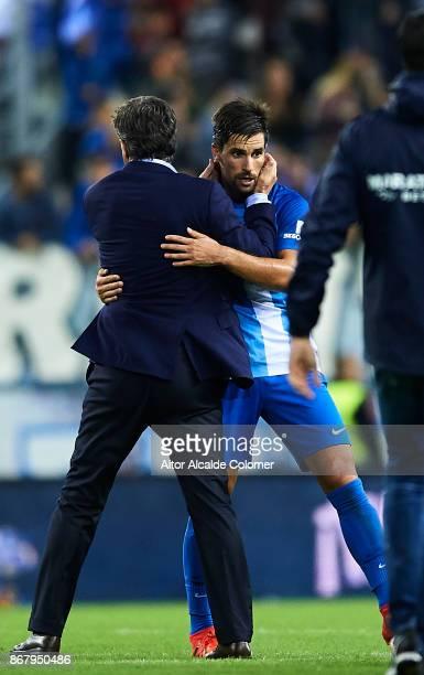 Head Coach of Malaga CF Michel Gonzalez celebrates after winning the match with Adrian Gonzalez of Malaga CF during the La Liga match between Malaga...