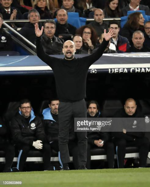 Head coach of Manchester City Pep Guardiola gives tactics to his players during the UEFA Champions League round of 16 first leg soccer match between...