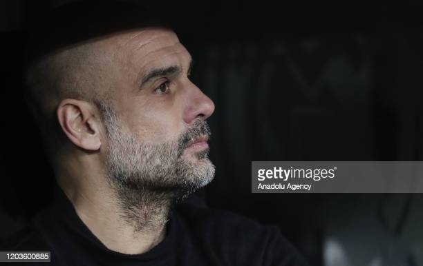 Head coach of Manchester City Pep Guardiola looks on during the UEFA Champions League round of 16 first leg soccer match between Real Madrid and...