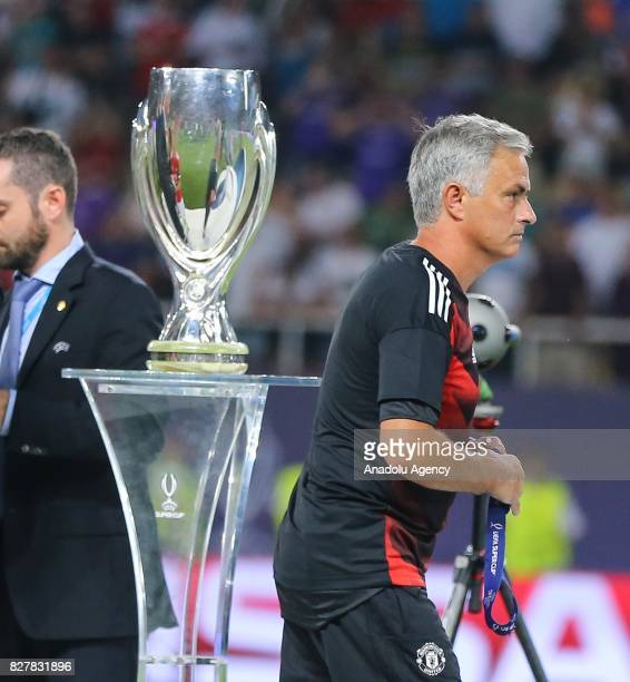 Head Coach of Manchester United Jose Mourinho gestures as he passes by the trophy after Real Madrid wins the UEFA Super Cup title in the final match...