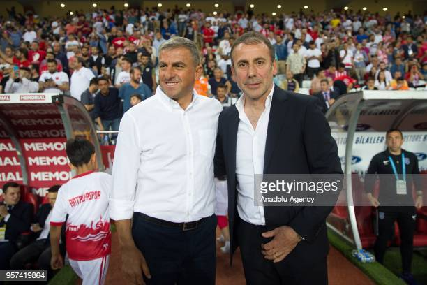 Head coach of Medipol Basaksehir Abdullah Avci and Antalyaspor's head coach Hamza Hamzaoglu pose for a photo ahead of the Turkish Super Lig match...