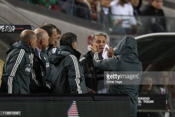 Head coach of Mexico Gerardo Martino reacts after being hit with the ball during the friendly match between Paraguay and Mexico at Levi's Stadium on...