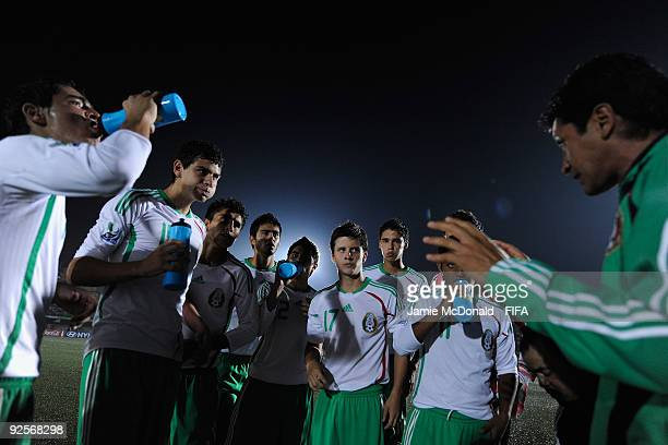 Head Coach of Mexico Jose Luis Gonzalez talks to his players during the FIFA U17 World Cup match between Japan and Mexico at the Teslim Balogun...