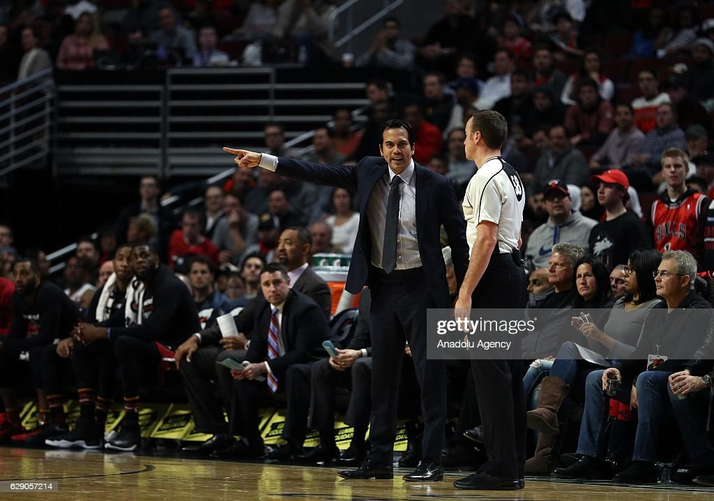 Head coach of Miami Heat Erik Spoelstra (L) reacts to Josh Tiven during the NBA match between Miami Heat and Chicago Bulls on December 10, 2016 at the United Center in Chicago, Illinois.
