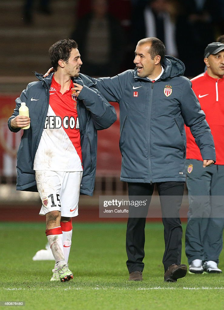 Head coach of Monaco Leonardo Jardim celebrates the victory with Bernardo Silva of Monaco (left) at the end of the French Ligue 1 match between AS Monaco FC v Olympique de Marseille OM at Stade Louis II on December 14, 2014 in Monaco.