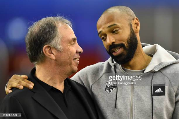 Head coach of New England Revolution Bruce Arena and head coach of the Montreal Impact Thierry Henry hug it out ahead of their MLS game at Olympic...
