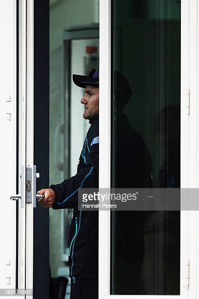 Head coach of New Zealand Mike Hesson looks out at the rain during day one of the First Test match between New Zealand and England at University Oval...