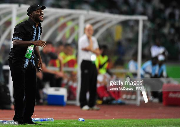Head coach of Nigeria John Obuh shouts instructions during the FIFA U17 World Cup Final match between Switzerland and Nigeria at the Abuja National...