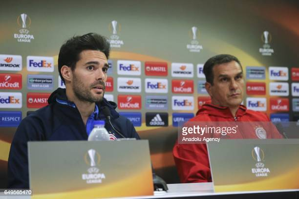 Head coach of Olympiacos Vasilis Vouzas and Alberto Botia of Olympiacos attend a press conference prior to the UEFA Europa League round of 16 match...