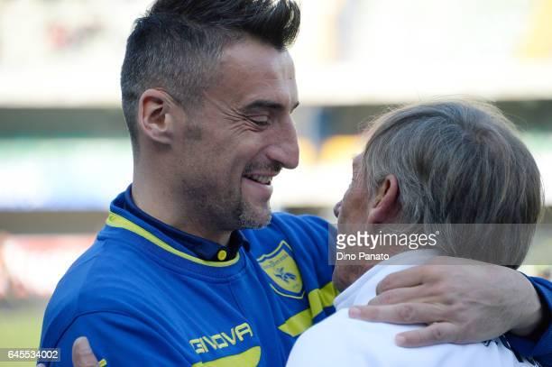 head coach of Pescara Calcio Zdenek Zeman speakes with Fabrizio Cacciatore of ChievoVerona before the Serie A match between AC ChievoVerona and...