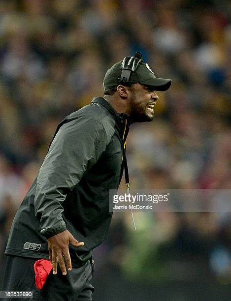 Head coach of Pittsburgh Steelers Mike Tomlin reacts during the NFL International Series game between Pittsburgh Steelers and Minnesota Vikings at...