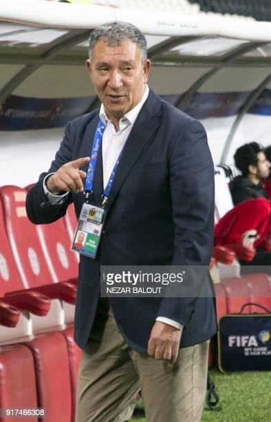 Head coach of Qatar's alJazira Dutch Henk ten Cate reacts during the AFC Champions League Round 1 Group Match between alJazira vs alGharafa at the...