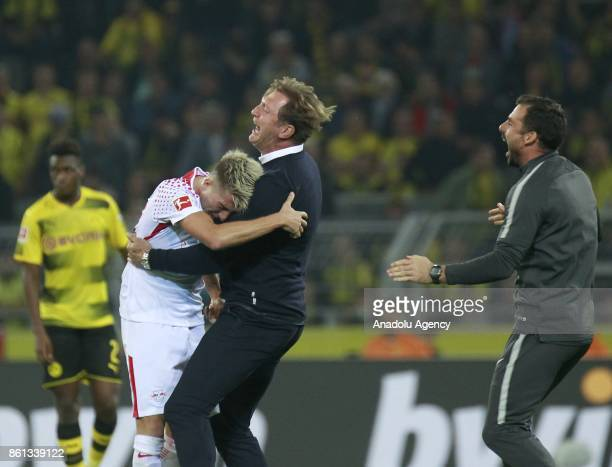 Head coach of Rasenballsport Leipzig Ralph Hasenhuettel celebrate with his player Kevin Kampl after winning the Bundesliga soccer match against...