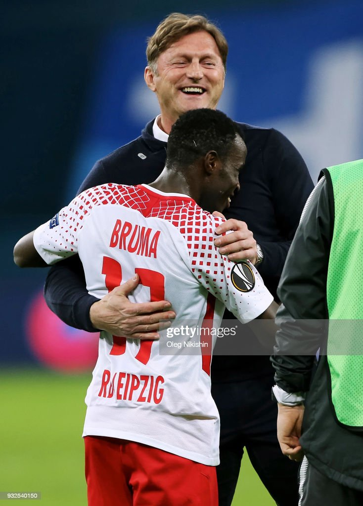 Head coach of RB Leipzig Ralph Hasenhuttl and Bruma celebrate after UEFA Europa League Round of 16 match between Zenit St Petersburg and RB Leipzig at the on March 15, 2018 in Saint Petersburg, Russia.