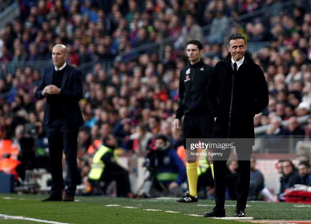 Head coach of Real Madrid Zinedine Zidane (L) and Head coach of Barcelona Luis Enrique (R) are seen during the La Liga football match between FC Barcelona and Real Madrid CF at Camp Nou Stadium in Barcelona, Spain on December 03, 2016.