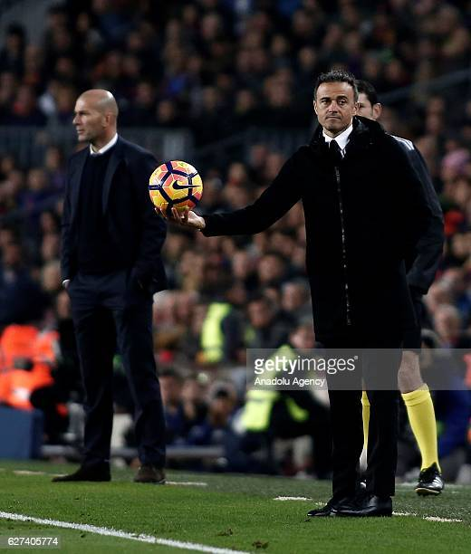 Head coach of Real Madrid Zinedine Zidane and Head coach of Barcelona Luis Enrique are seen during the La Liga football match between FC Barcelona...